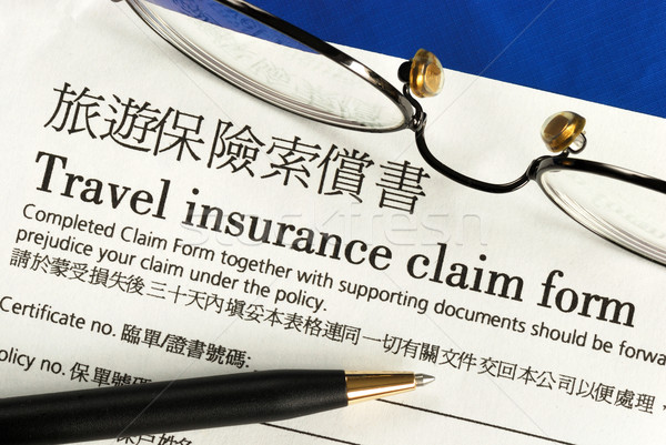 Travel insurance claim form in both English and Chinese Stock photo © johnkwan