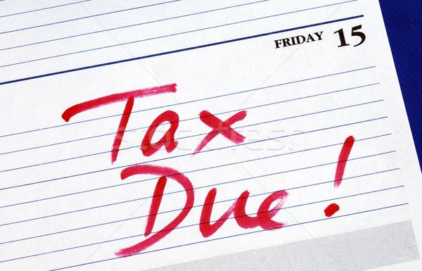 Fecha ingresos impuesto papel servicio financieros Foto stock © johnkwan