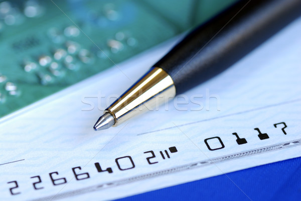Write a check to pay the credit card bill isolated on blue Stock photo © johnkwan