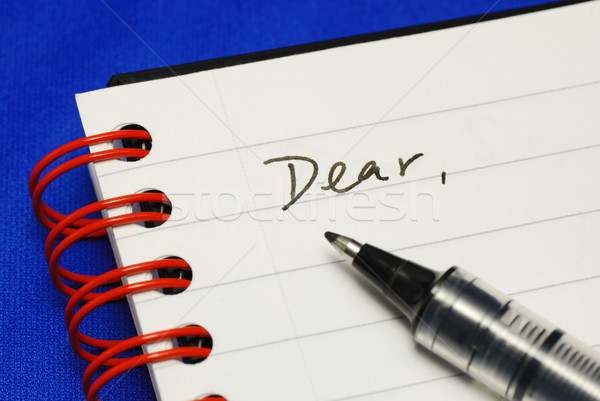 The word Dear with a pen concepts of writing a letter isolated on blue Stock photo © johnkwan