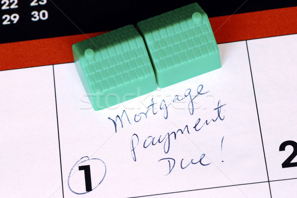Be sure to pay the home mortgage on time  Stock photo © johnkwan