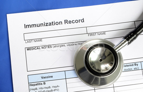 Immunization Record concept of vaccination and disease prevention Stock photo © johnkwan