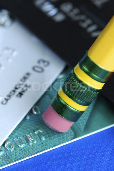 Erase the debt on the credit cards isolated on blue Stock photo © johnkwan