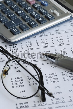Stock photo: Reviewing the financial report of a company