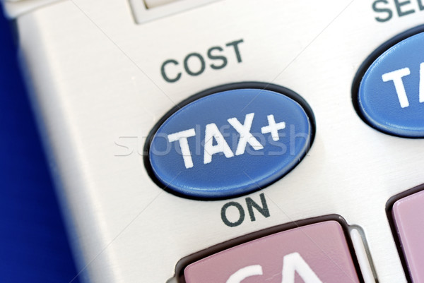 Tax is an important factor in a business isolated on blue Stock photo © johnkwan