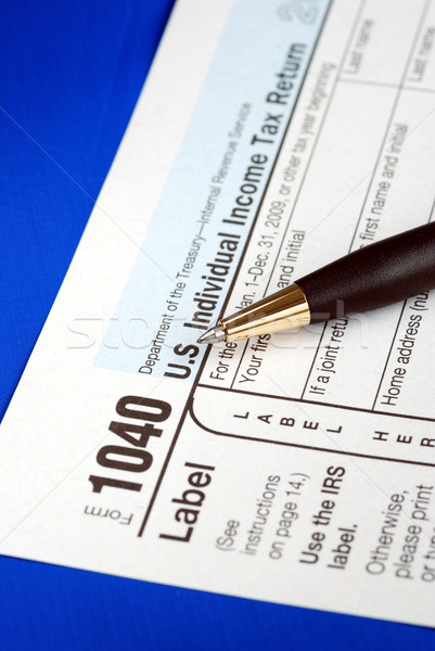 Working on the United States Income Tax 1040 isolated on blue Stock photo © johnkwan
