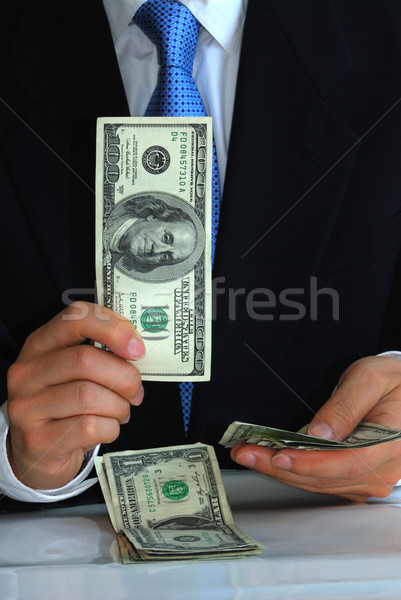 A gentleman holding the $100 bill like flipping playing cards Stock photo © johnkwan