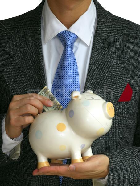 Cavalheiro dinheiro piggy bank financeiro aposentadoria Foto stock © johnkwan