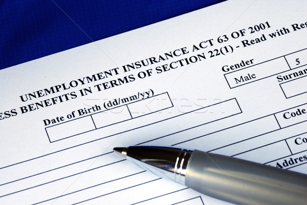 Filling the unemployment insurance application form isolated in blue  Stock photo © johnkwan