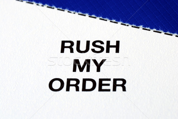 """Rush My Order"" from a business reply postcard isolated on blue Stock photo © johnkwan"