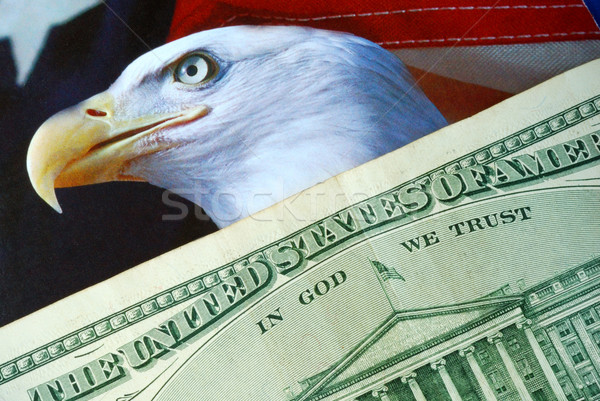 A dollar bill on the American Eagle flag Stock photo © johnkwan