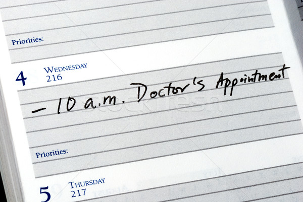 Mark the doctor appointment in the day planner Stock photo © johnkwan
