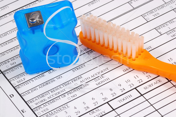 Dental claim form with toothbrush concepts of the rising cost of dental care Stock photo © johnkwan