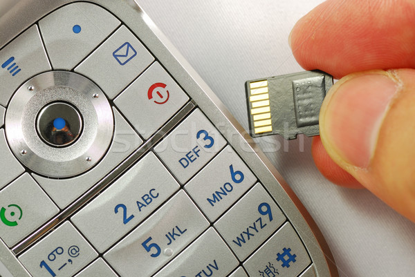 Cellular phone with a memory card concepts of wireless communication Stock photo © johnkwan