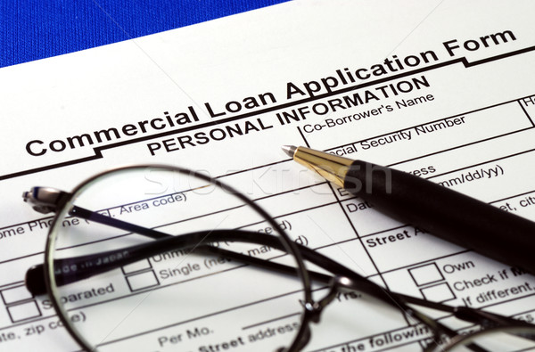 File the commercial loan application isolated on blue Stock photo © johnkwan