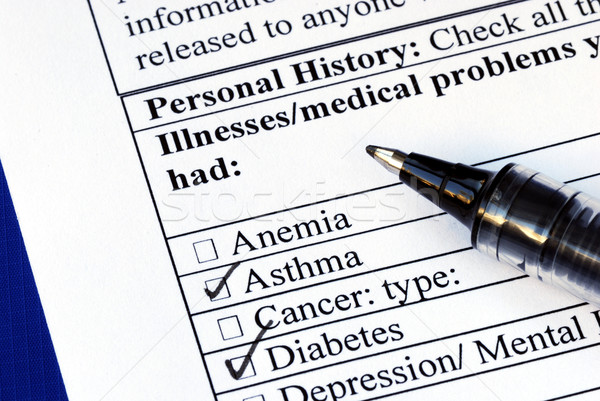 Stock photo: Patient selects the illness in the medical history section isolated on blue