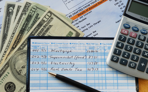 Write some checks to make payments for household expenses  Stock photo © johnkwan
