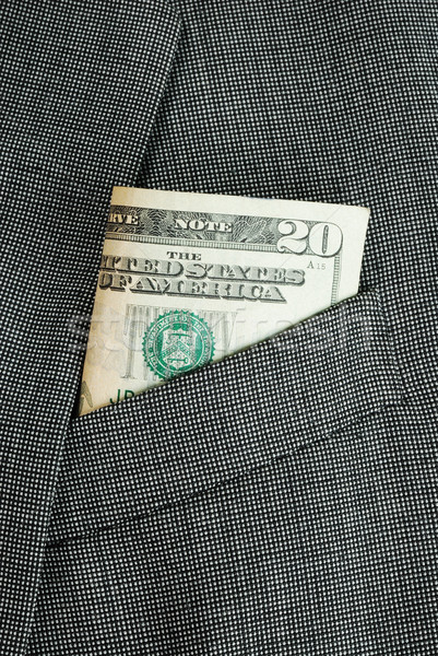 Money in a business suit pocket concepts of business finance Stock photo © johnkwan