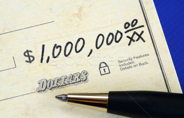 Write a check of one million dollars concept of wealth Stock photo © johnkwan