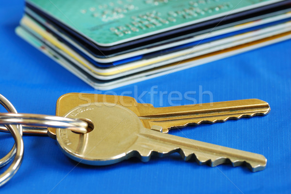 Obtain the credit to buy real estate isolated on blue Stock photo © johnkwan