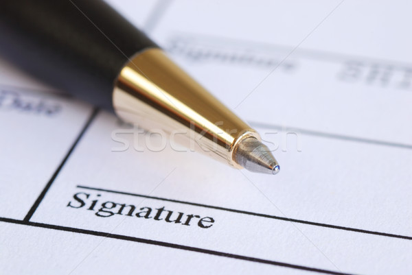 Sign the name on a paper with a pen Stock photo © johnkwan