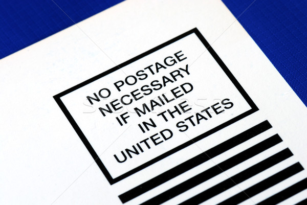 No postage is necessary to mail in the U.S. isolated on blue Stock photo © johnkwan