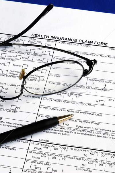 Stock photo: Fill the health insurance claim form isolated on blue