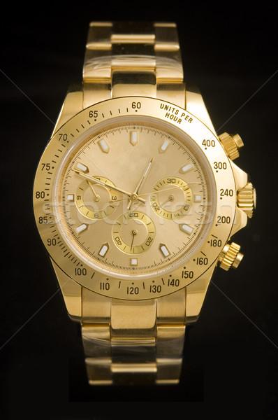 Luxus arany óra izolált fekete kéz Stock fotó © johnnychaos