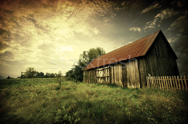 sunset by an old barn Stock photo © johnnychaos