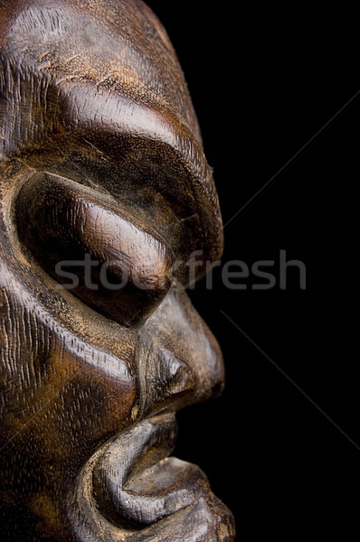 African mask over black background Stock photo © johnnychaos