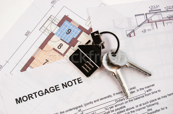 Keys on mortgage note Stock photo © johnnychaos