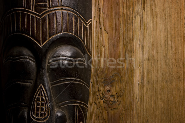 African mask over wooden background Stock photo © johnnychaos