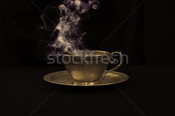 Quente café ouro antigo copo fumar Foto stock © johnnychaos