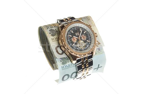 Luxury gold watch around polish banknotes Stock photo © johnnychaos