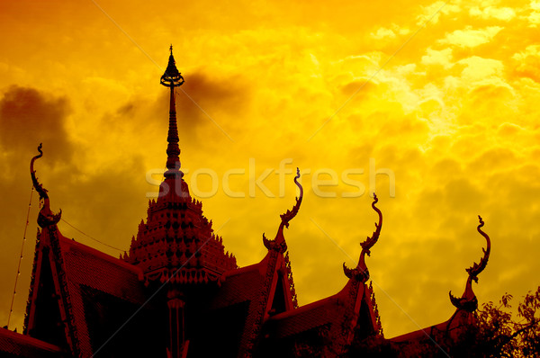 Sunset with temple silhouette Stock photo © johnnychaos