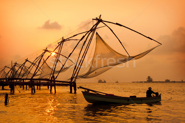 Sunset over Chinese Fishing nets in Cochin Stock photo © johnnychaos