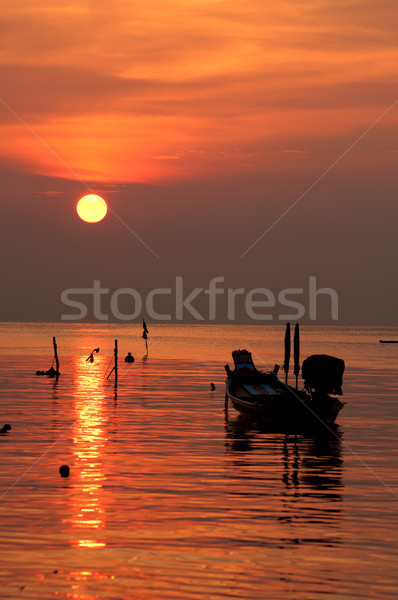 Sunset with boat on tropical beach Stock photo © johnnychaos