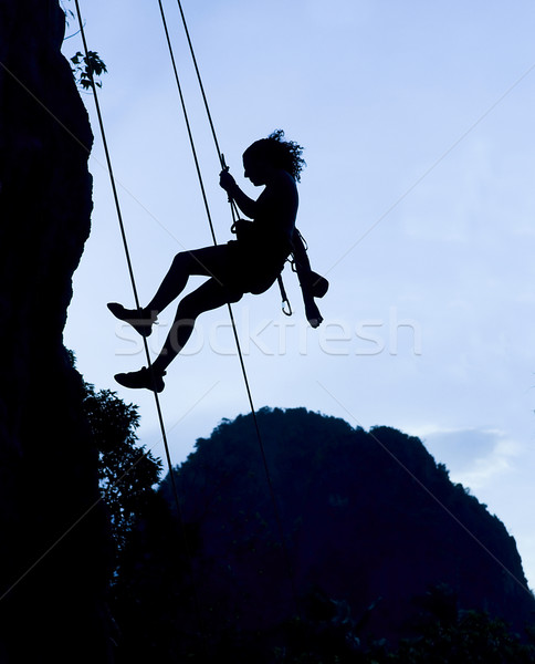 Climbing woman silhouette Stock photo © johnnychaos