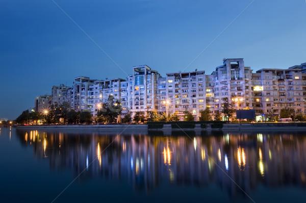 зданий воды Бухарест закат свет Сток-фото © johny007pan