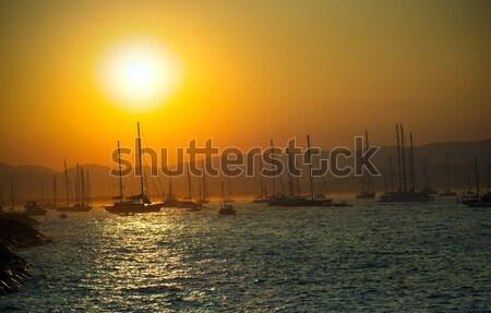 Voile bateaux mer coucher du soleil paysage Photo stock © johny007pan