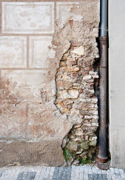 Oude muur gebarsten gips Praag straten Stockfoto © Johny87