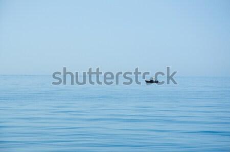 Solitário pescador abrir azul mar céu Foto stock © Johny87