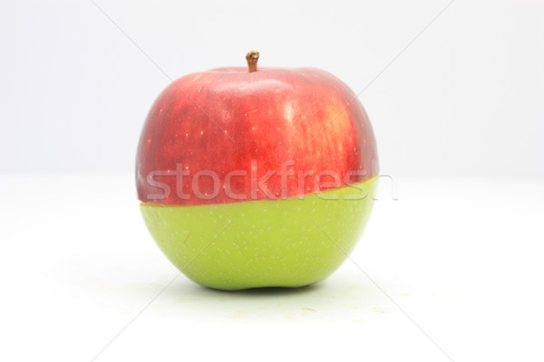 Apple red on green (haft) Stock photo © jomphong