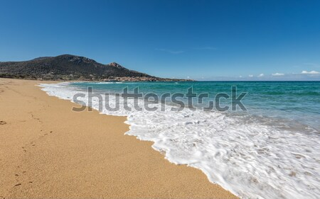 Two people walking along the beach at Sagone in Corsica Stock photo © Joningall
