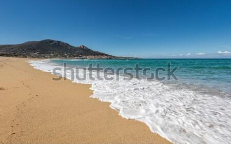 Сток-фото: два · человека · ходьбе · пляж · Корсика · следов · песок