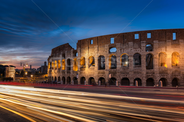 Light trails pass the Colosseum in Rome at dusk Stock photo © Joningall