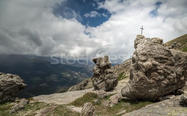 Croix Rock corse fer sombre nuages Photo stock © Joningall