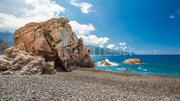 Rocks and pebble beach at Bussaglia on west coast of Corsica Stock photo © Joningall