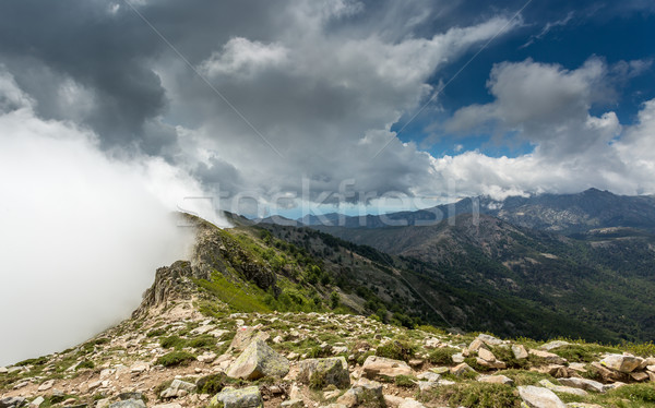 Clouds meet the top of a mountain ridge on GR20 in Corsica Stock photo © Joningall