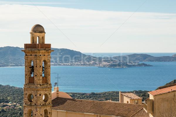 church tower of Lumio with Calvi in background Stock photo © Joningall